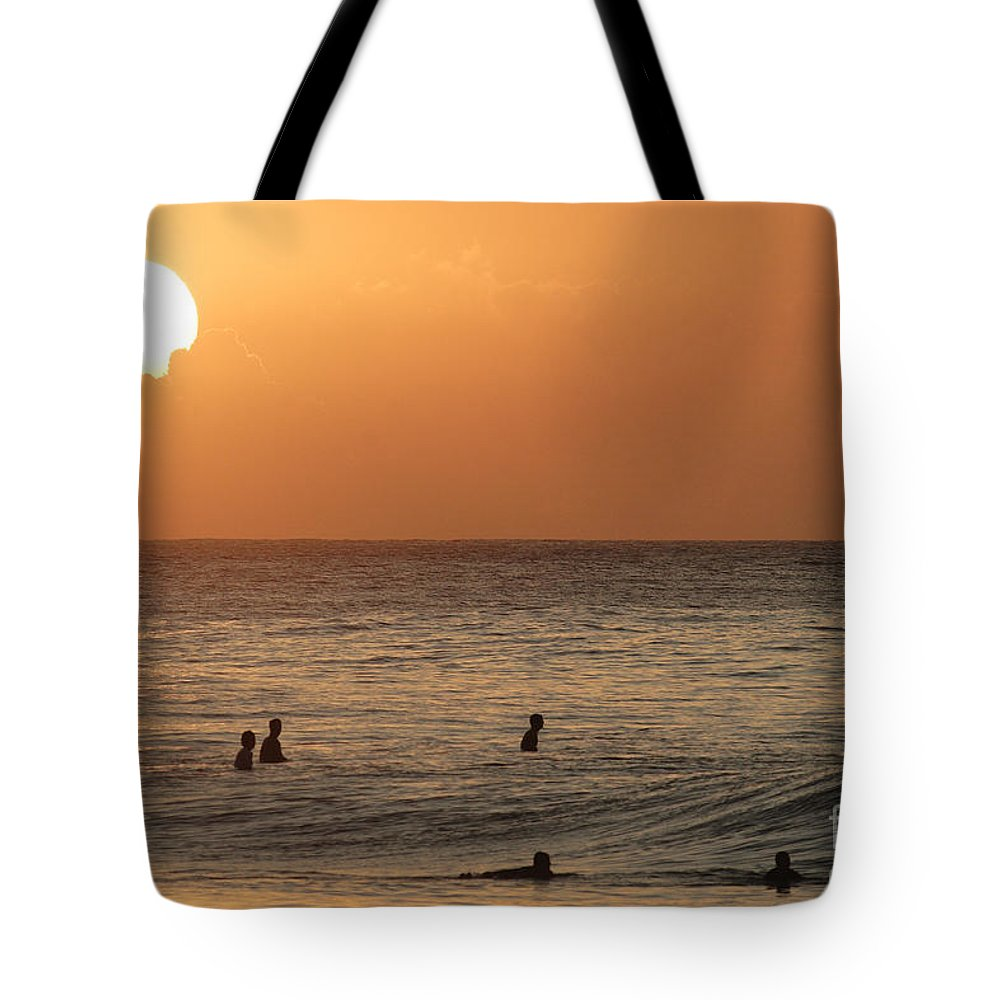 Calm Tote Bag featuring the photograph Surfers At Sunset by Vince Cavataio - Printscapes