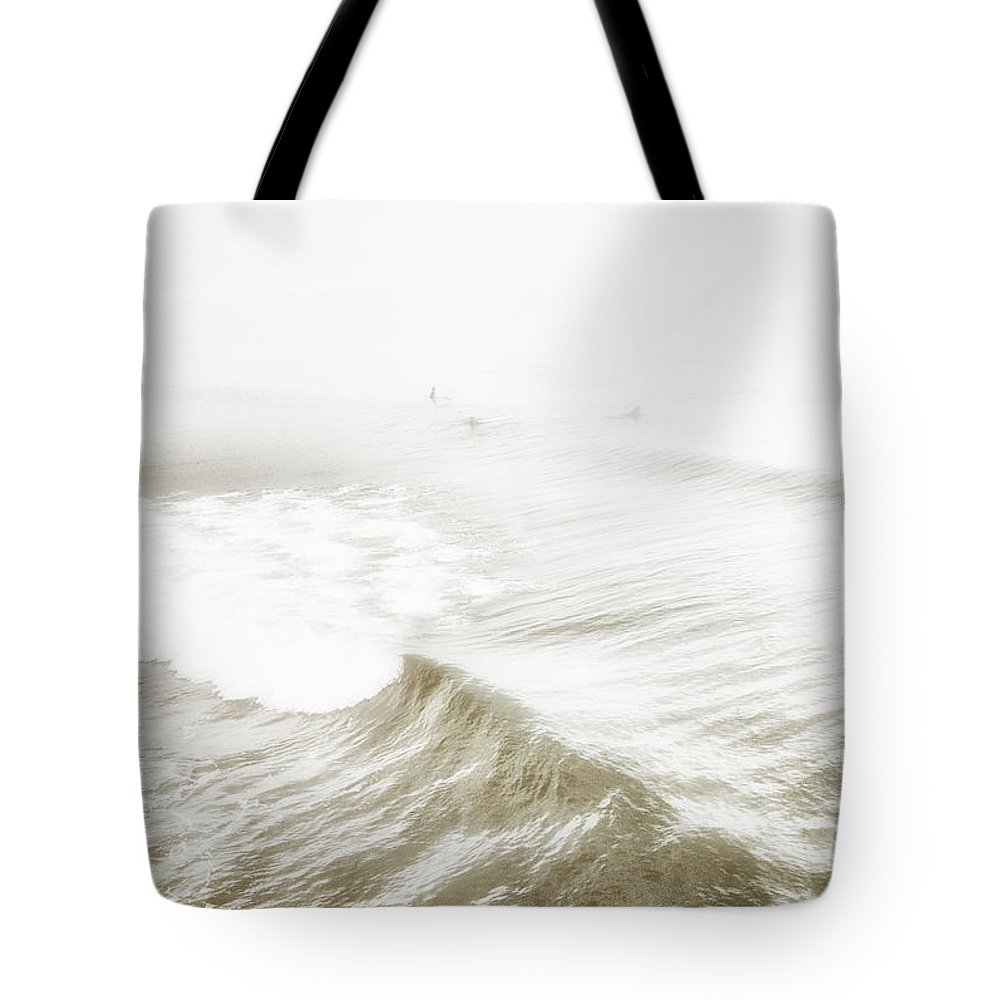 Surfers Tote Bag featuring the photograph Surfers In Ocean Mist by A Gurmankin
