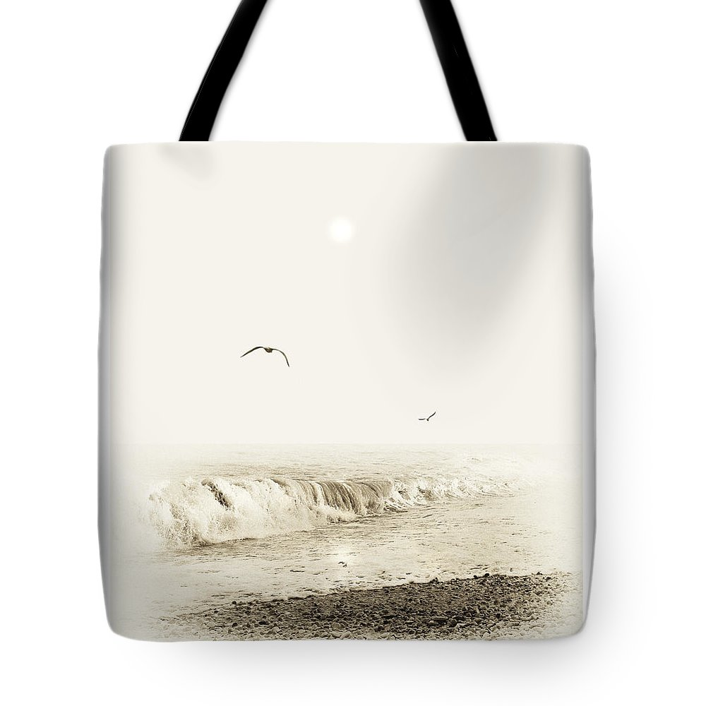 Beach Tote Bag featuring the photograph Surfers by Mal Bray
