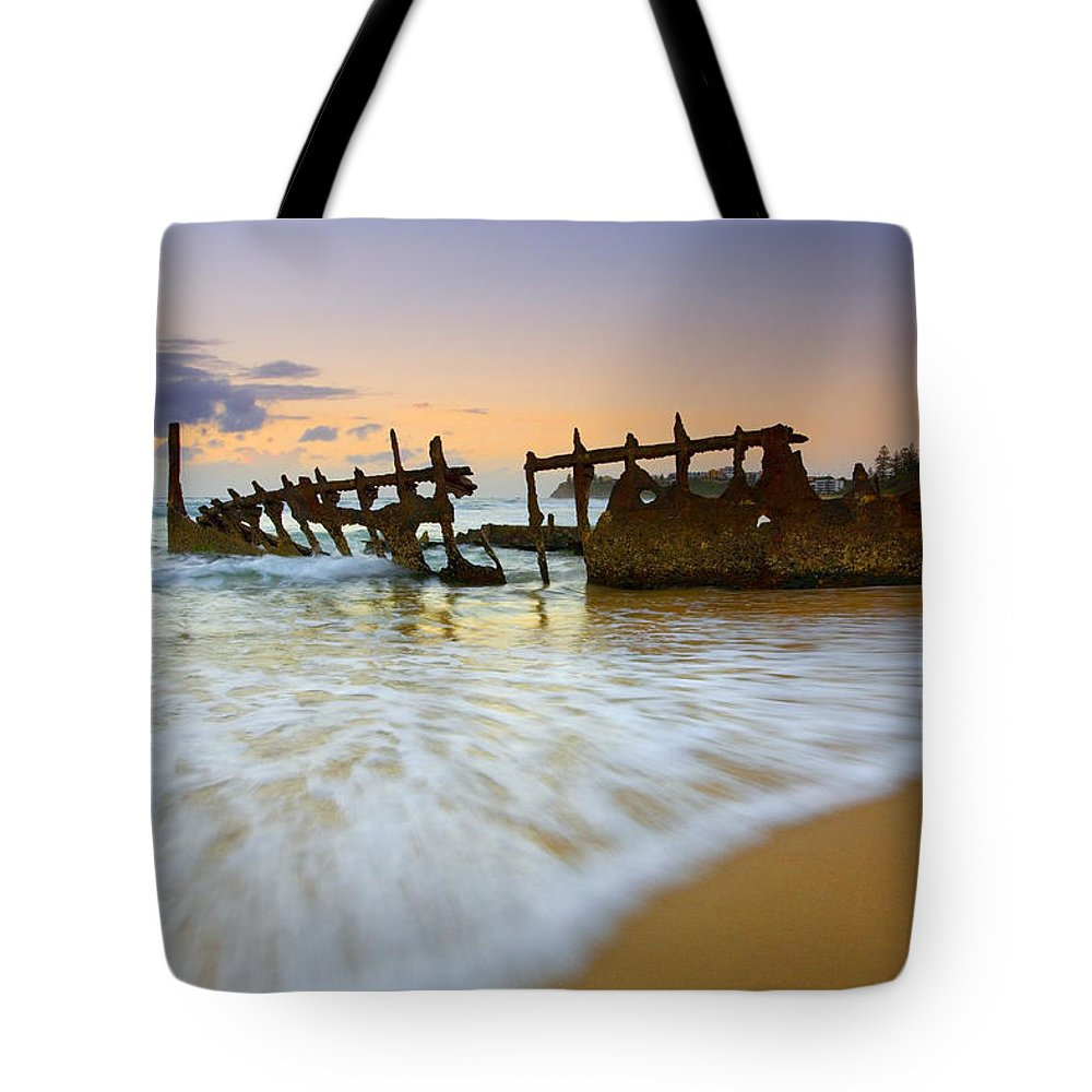 Shipwreck Tote Bag featuring the photograph Swallowed By The Tides by Mike Dawson