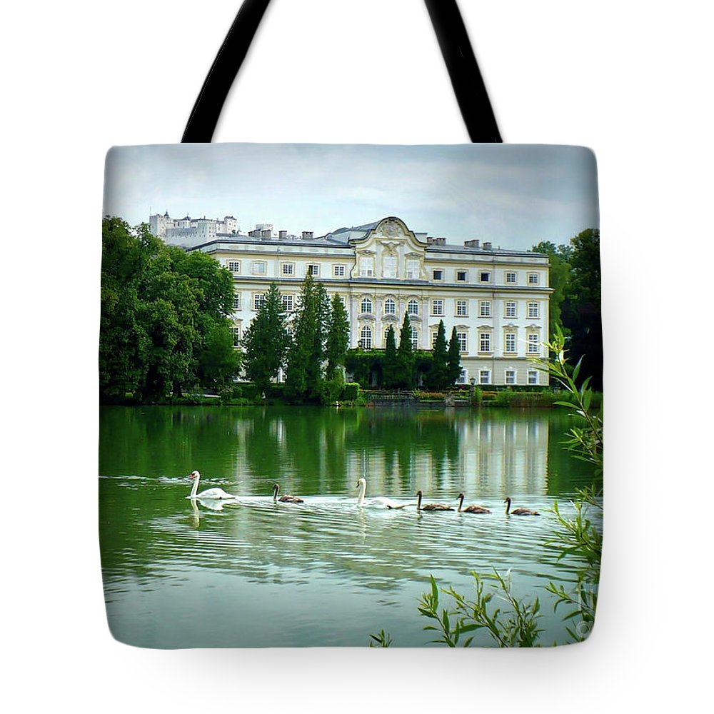 Austrian Lake Tote Bag featuring the photograph Swans On Austrian Lake by Carol Groenen