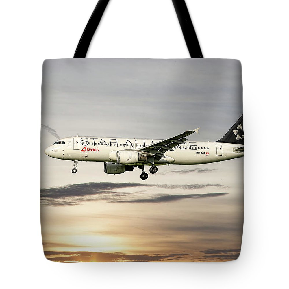 Swiss Tote Bag featuring the mixed media Swiss Star Alliance Livery Airbus A320-214 3 by Smart Aviation