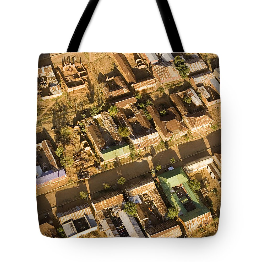 Africa Tote Bag featuring the photograph Tanzanian Courtyard Homes Are Clustered by Michael Fay