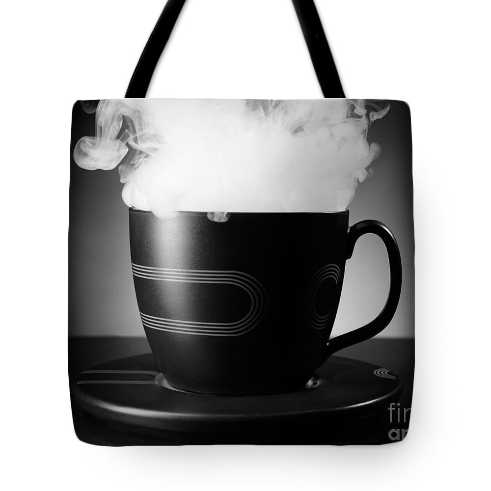 Tea Cup Tote Bag featuring the photograph Tea Cup by Oleksiy Maksymenko