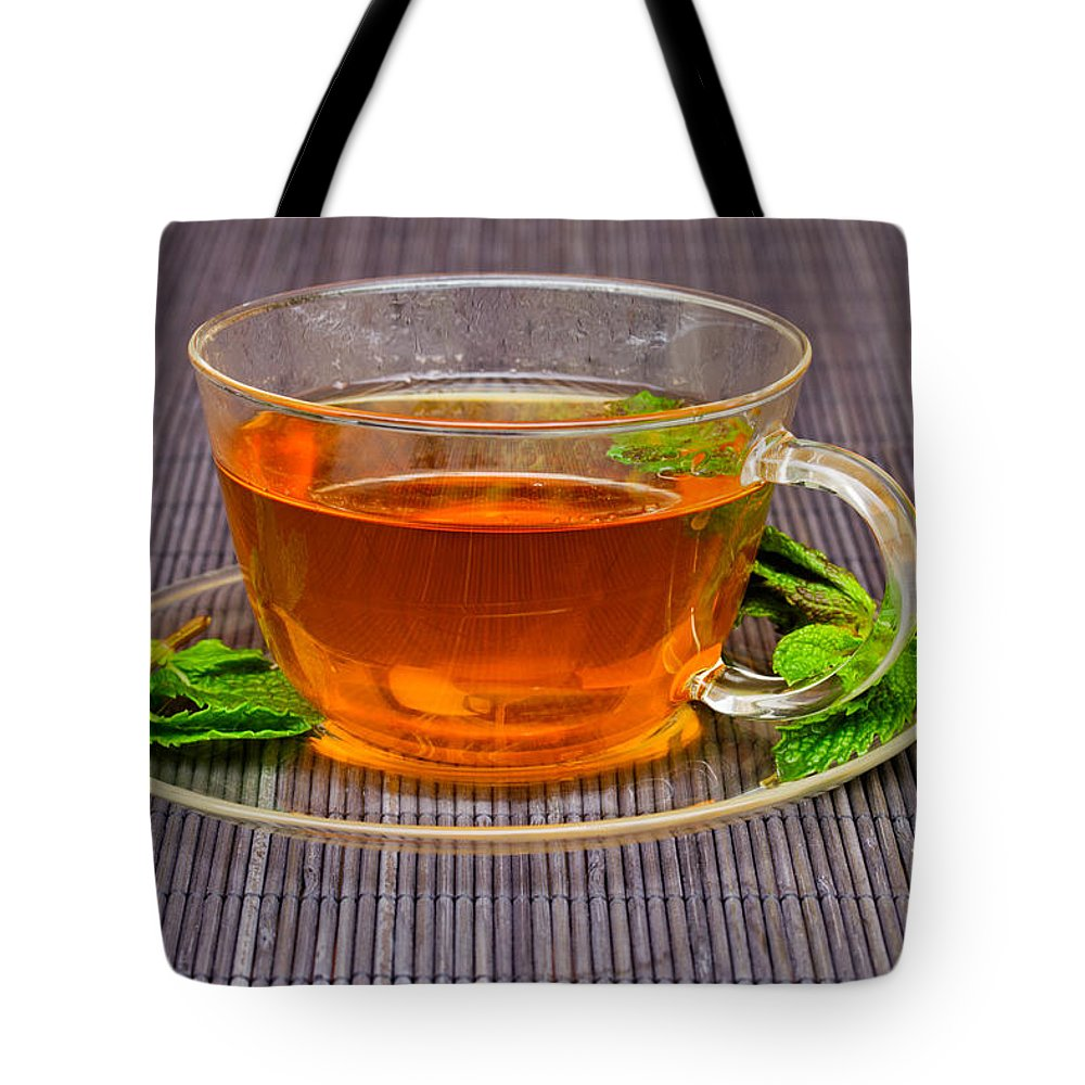 Tea Tote Bag featuring the photograph Tea With Mint by Anastasy Yarmolovich