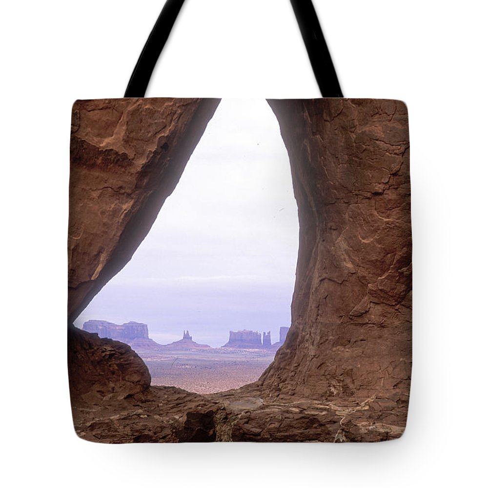 Monument Valley Tote Bag featuring the photograph Teardrop Arch-monument Valley by Sandra Bronstein