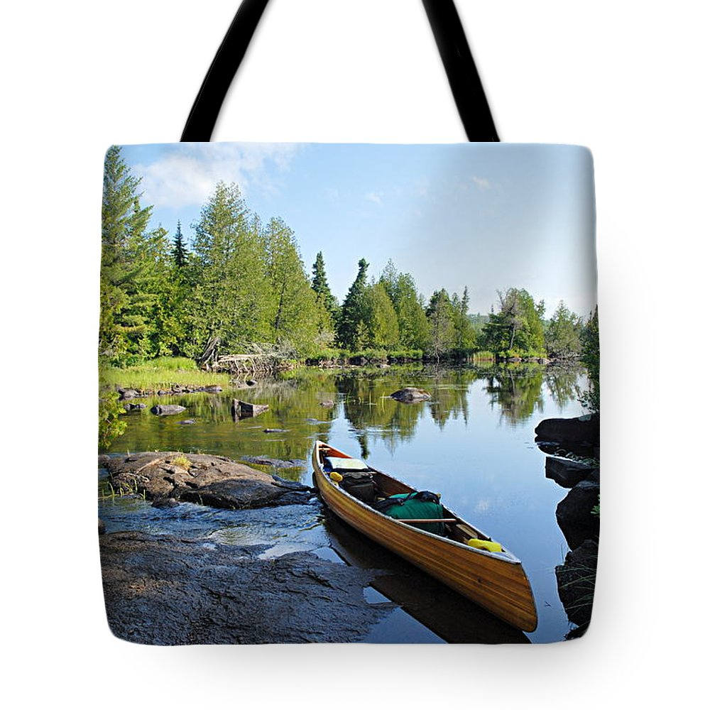 Boundary Waters Canoe Area Wilderness Tote Bag featuring the photograph Temperance River Portage by Larry Ricker