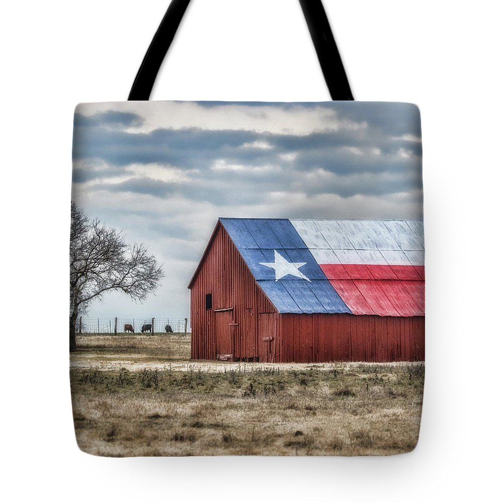 Texas Tote Bag featuring the photograph Texas Flag Barn #1 by Ronnie Prcin