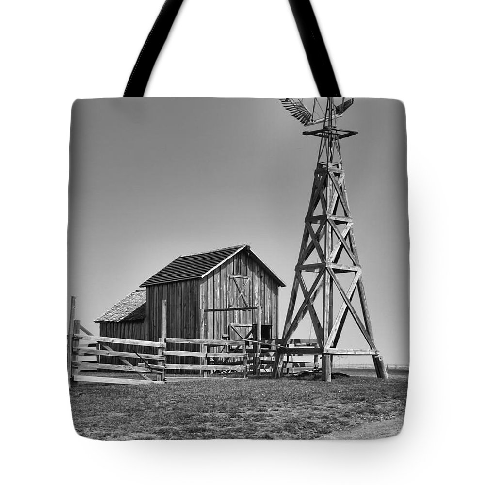 Ann Keisling Tote Bag featuring the photograph The Barn And Windmill by Ann Keisling