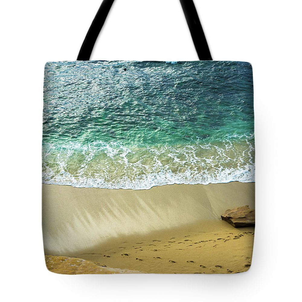 Beach Tote Bag featuring the photograph The Beach by Moshe Levis