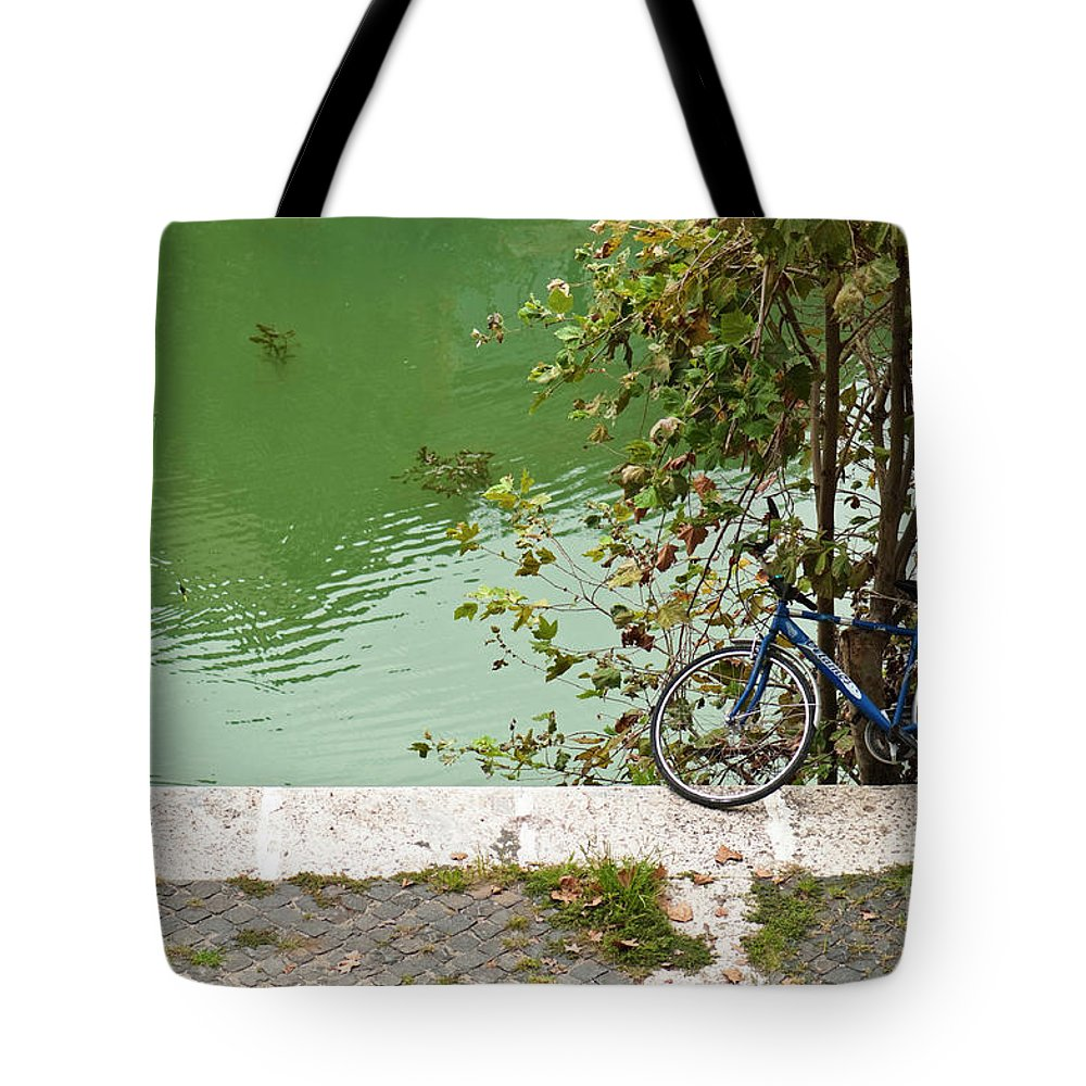 Bicycle Tote Bag featuring the photograph The Bicycle Is A Ubiquitous Form Of Transport In Europe And This Owner Has Literally Gone Fishing. by Lionel Everett