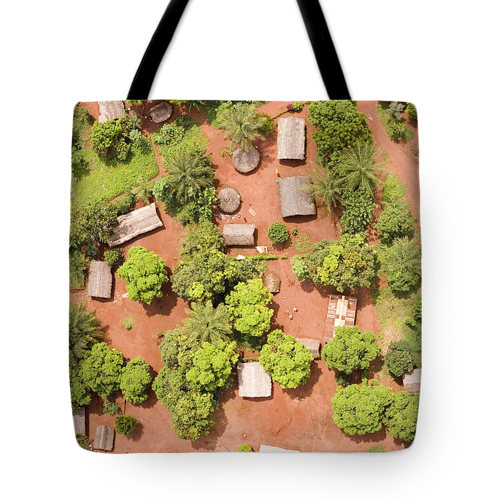 Landscape Tote Bag featuring the photograph The Border Town Village Of Bangassou by Michael Fay