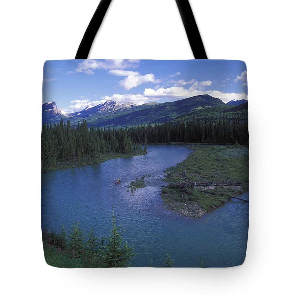 Landscapes Tote Bag featuring the photograph The Bow River And Castle Mountain by Rich Reid