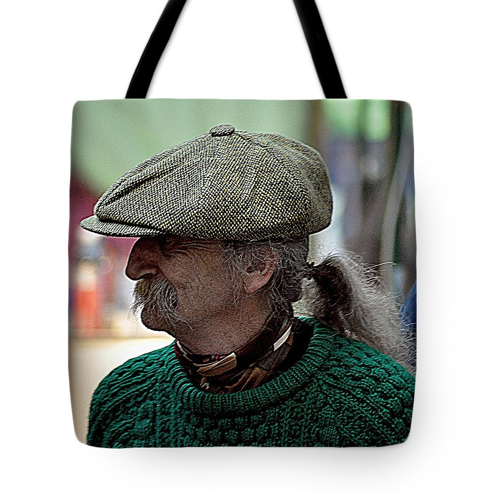 Cap Tote Bag featuring the photograph The Cap by John Hughes