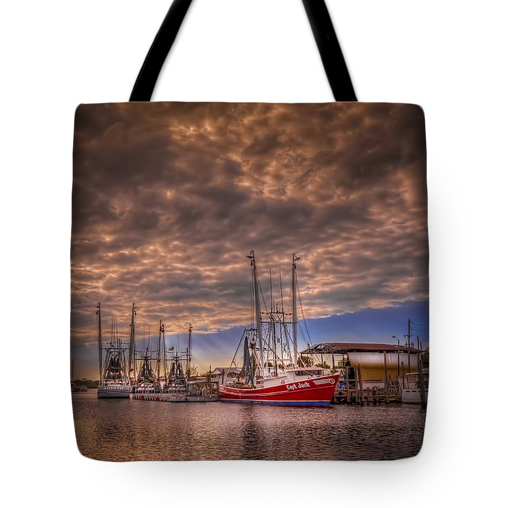 Clouds Tote Bag featuring the photograph The Captain Jack by Marvin Spates