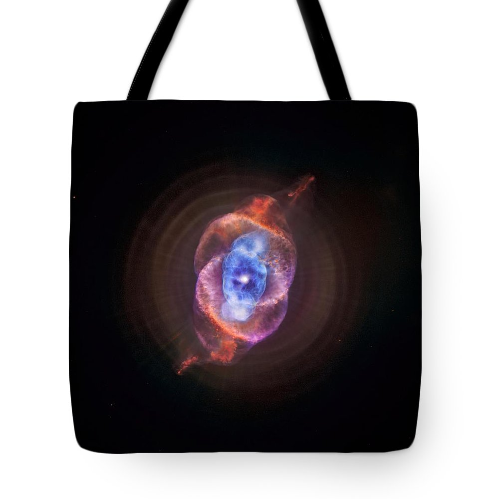 Nasa Tote Bag featuring the photograph The Cat's Eye Nebula by Nasa