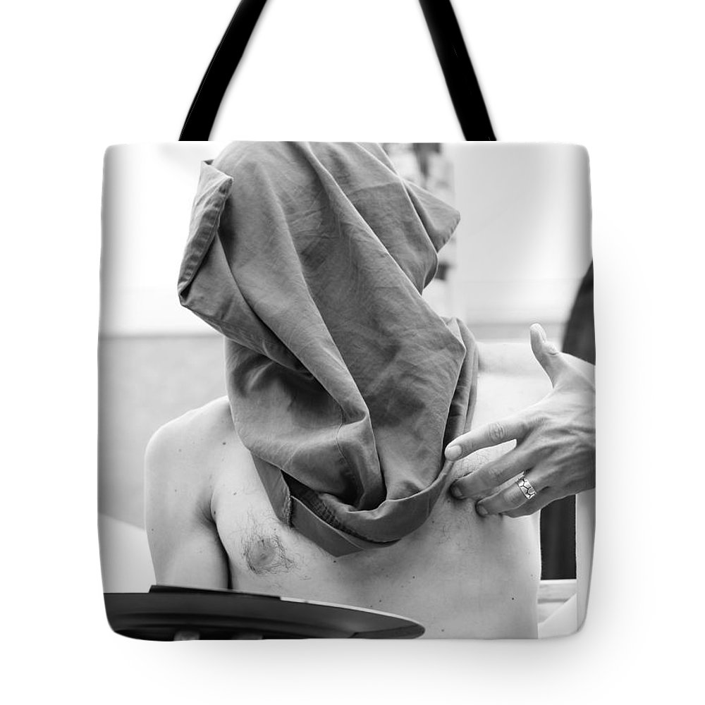 Street Photography Tote Bag featuring the photograph The Cooperate Itch by The Artist Project