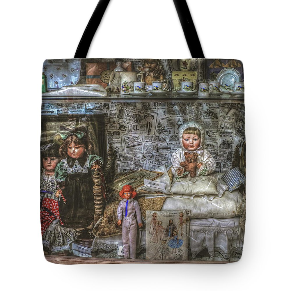 Dolls Tote Bag featuring the photograph The Dolls by Wild Fire