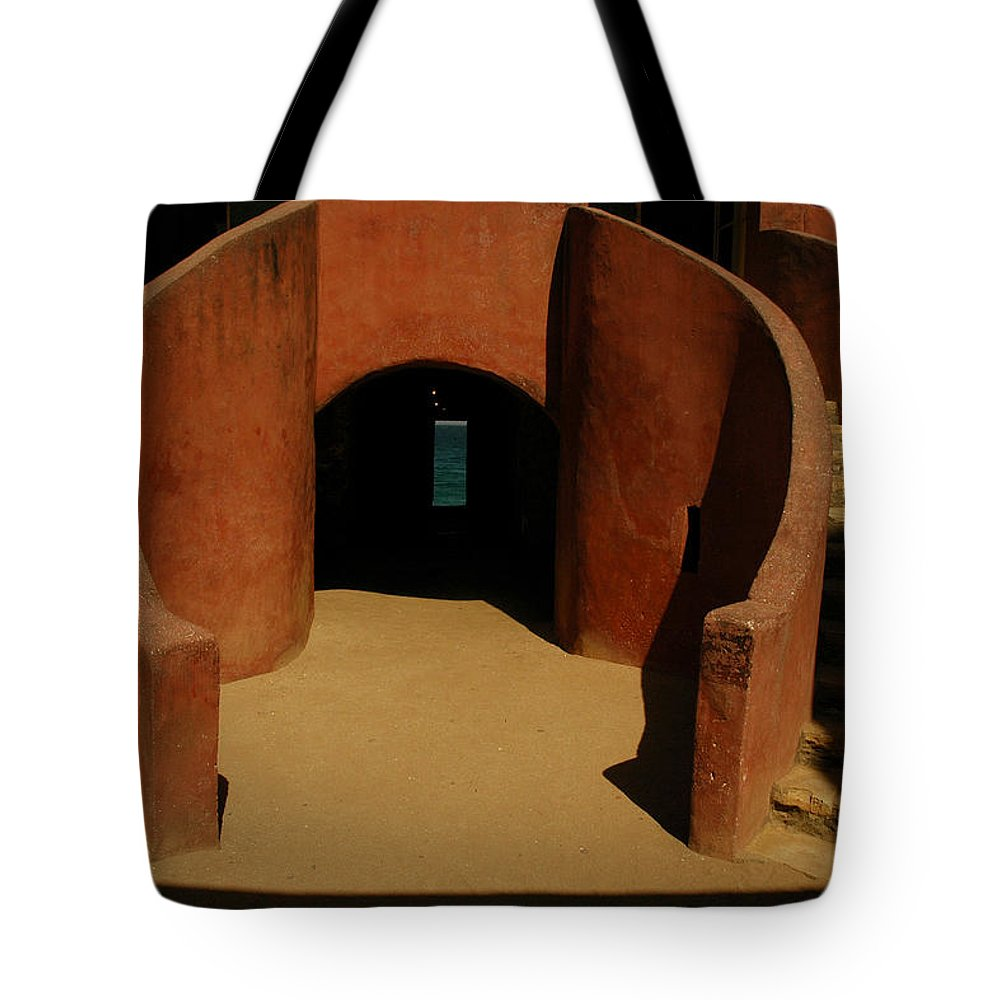 Africa Tote Bag featuring the photograph The Door Of No Return On Goree Island by Bobby Model