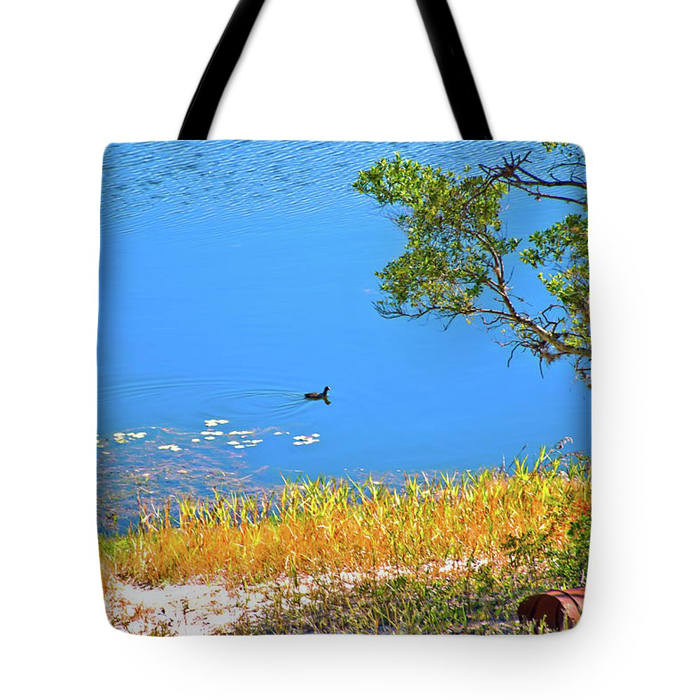 Lake Tote Bag featuring the photograph The Duck by Gina O'Brien