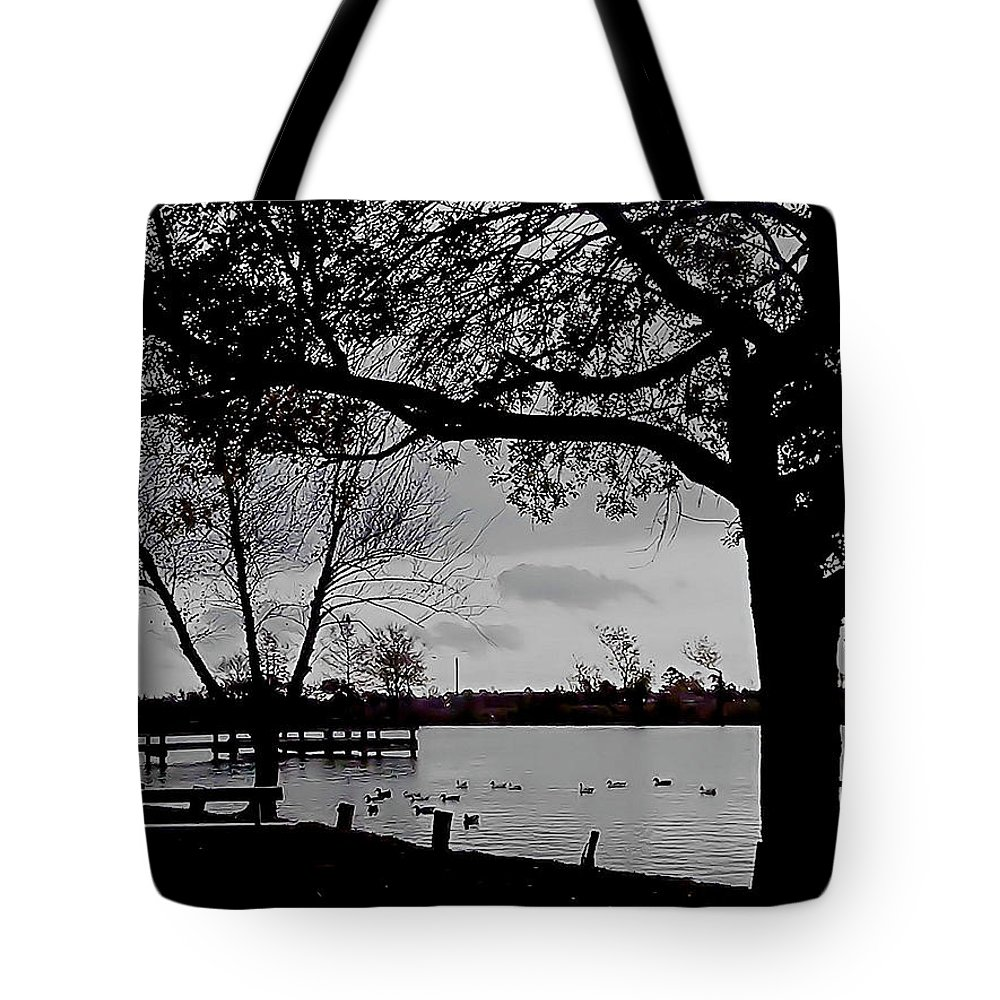Black And White Tote Bag featuring the photograph The Duck Pond by Karen Wagner