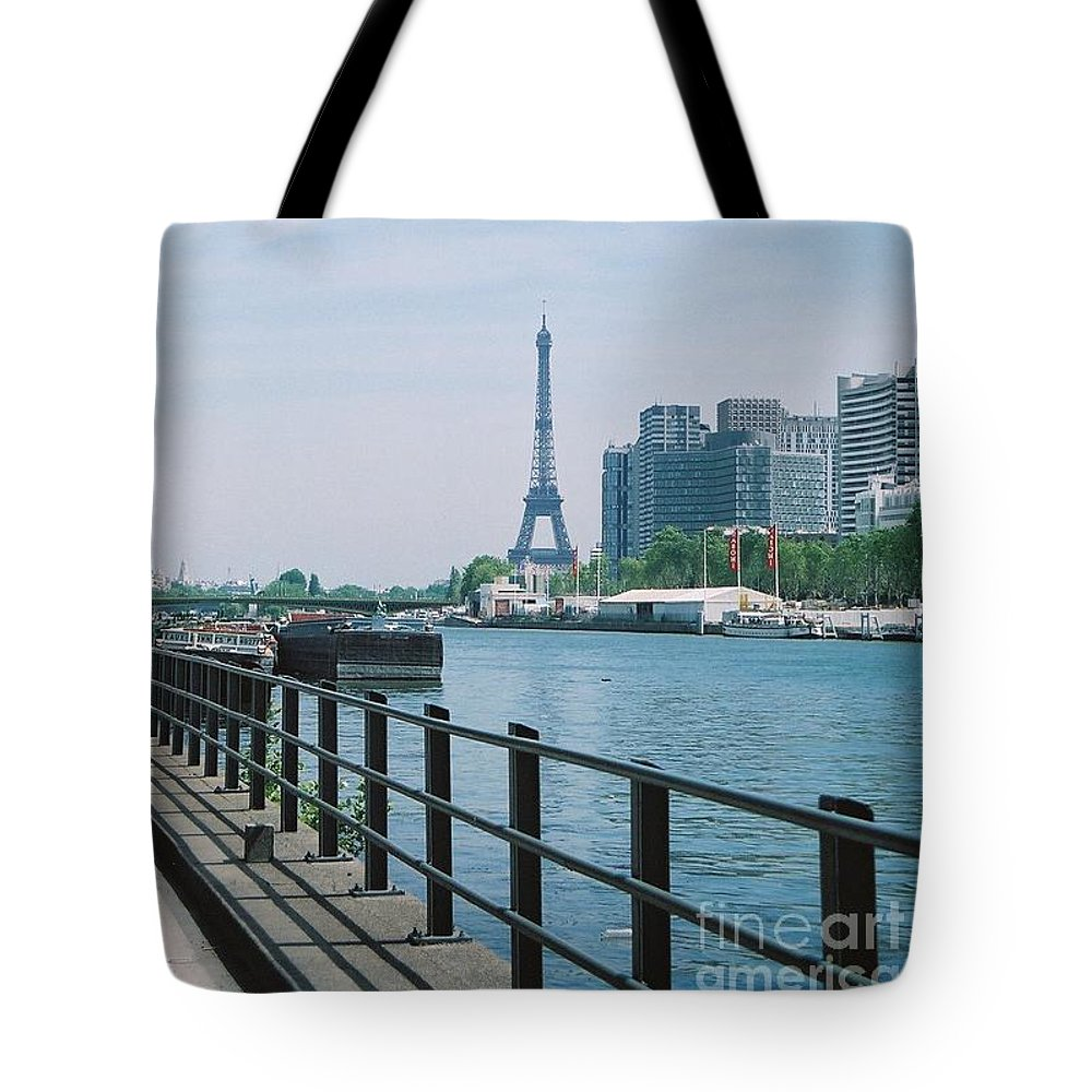The Eiffel Tower Tote Bag featuring the photograph The Eiffel Tower And The Seine River by Nadine Rippelmeyer