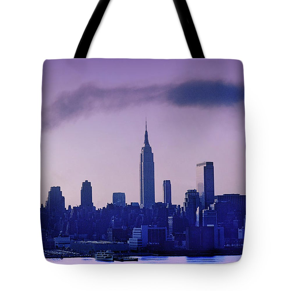 Empire State Building Tote Bag featuring the photograph The Empire State Building In New York At 6 A. M. In January by Yuri Lev