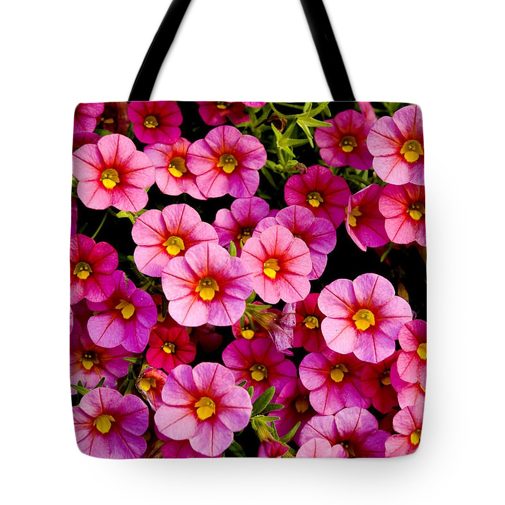 Flowers Tote Bag featuring the photograph The Eyes by Greg Fortier