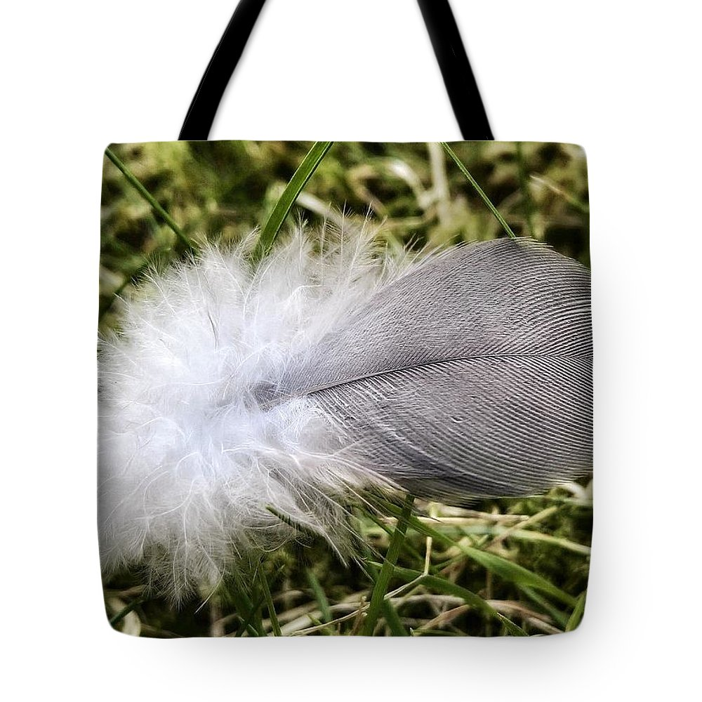 Tote Bag featuring the photograph The Feather by Andrea Otte
