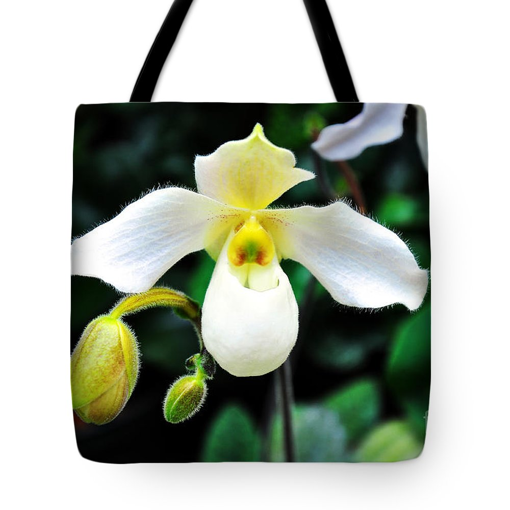 Orchid Tote Bag featuring the photograph The Flying Orchid by Andee Design