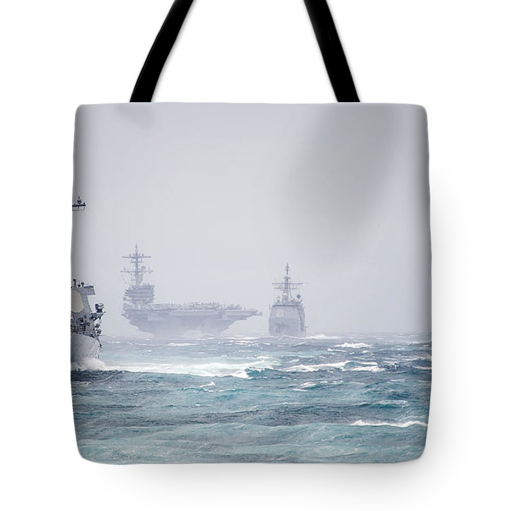 The George H.w. Bush Carrier Strike Group Is Underway In The Atlantic Ocean Tote Bag featuring the painting The George H.w. Bush Carrier by Celestial Images