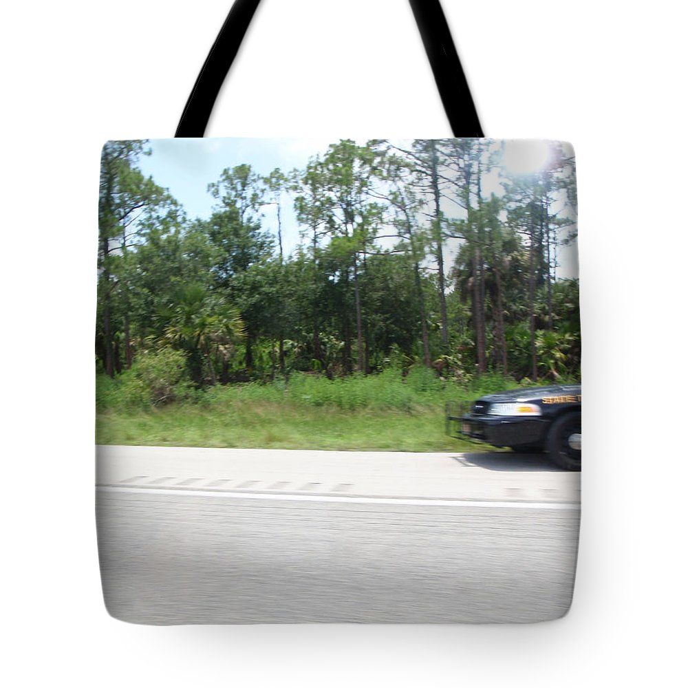 Getaway Tote Bag featuring the photograph The Getaway by Are Lund