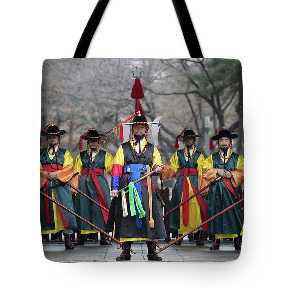 Asia Tote Bag featuring the photograph The Guards Of Seoul. by Peteris Vaivars
