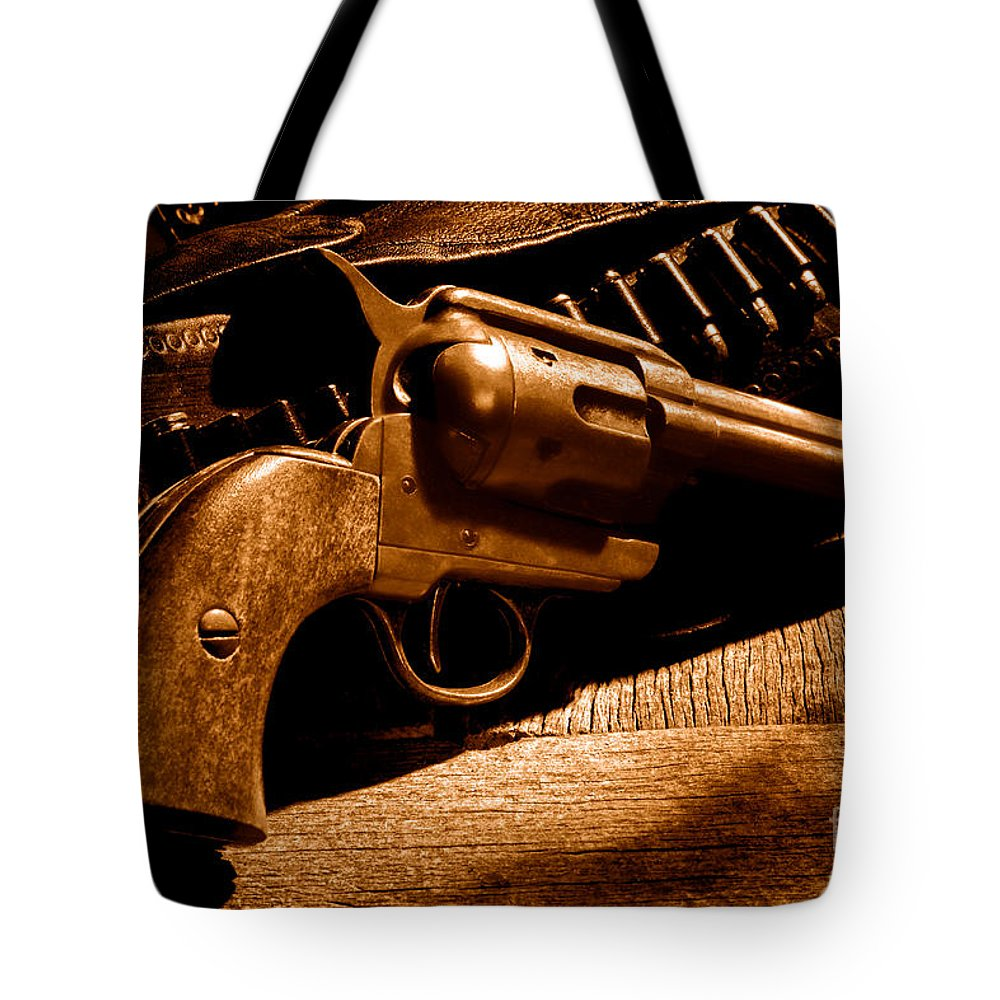 Revolver Tote Bag featuring the photograph The Gun That Won The West - Sepia by Olivier Le Queinec
