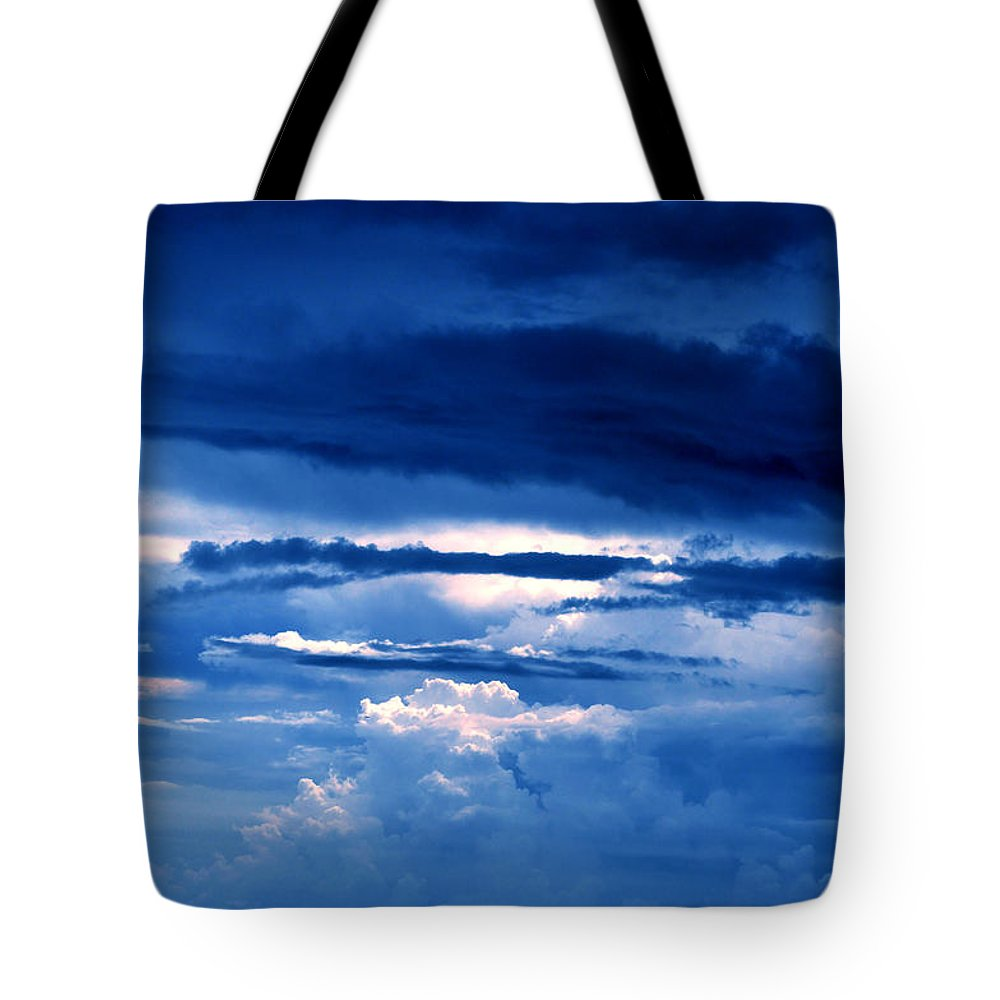 Hiding Tote Bag featuring the photograph The Hiding Sun by Bliss Of Art