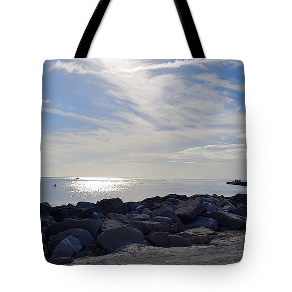 Rocks Tote Bag featuring the photograph The Jetty by Ric Schafer