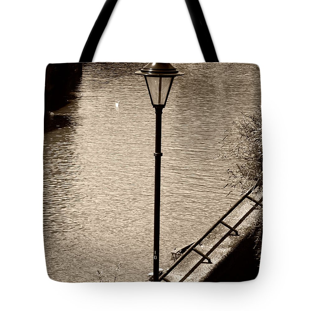 Bridge Street Steps Tote Bag featuring the photograph The Lamp by Brian Roscorla