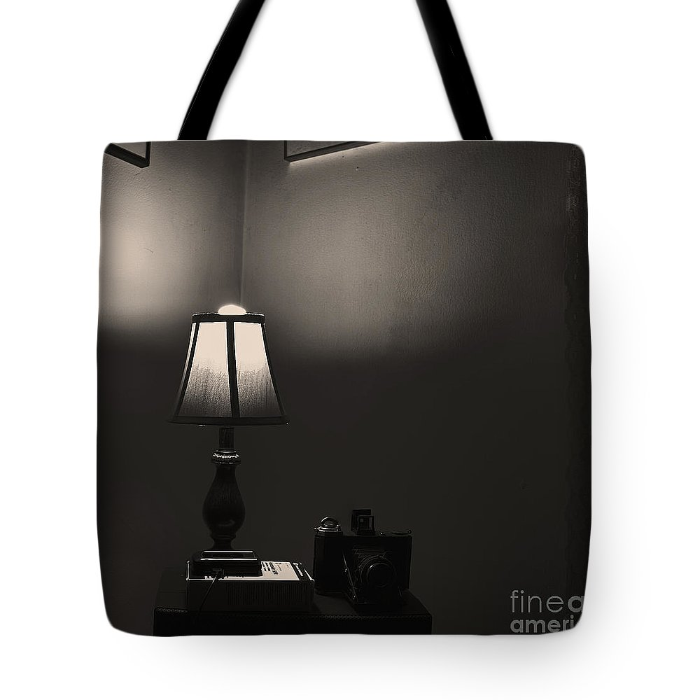 Still Life Tote Bag featuring the photograph The Lamp Shade. by Itai Minovitz