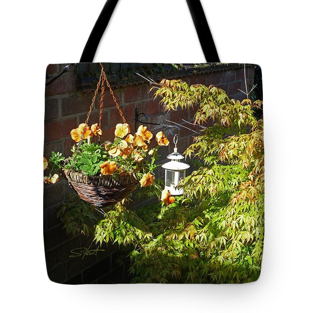 Hanging Basket Tote Bag featuring the photograph The Lantern by Charles Stuart