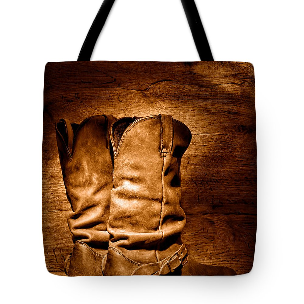 Cowboy Tote Bag featuring the photograph The Legendary Cowboy Boots - Sepia by Olivier Le Queinec
