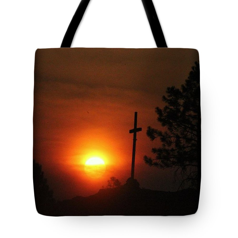 Sun Tote Bag featuring the photograph The Light In The Dark by Roxanne Basford