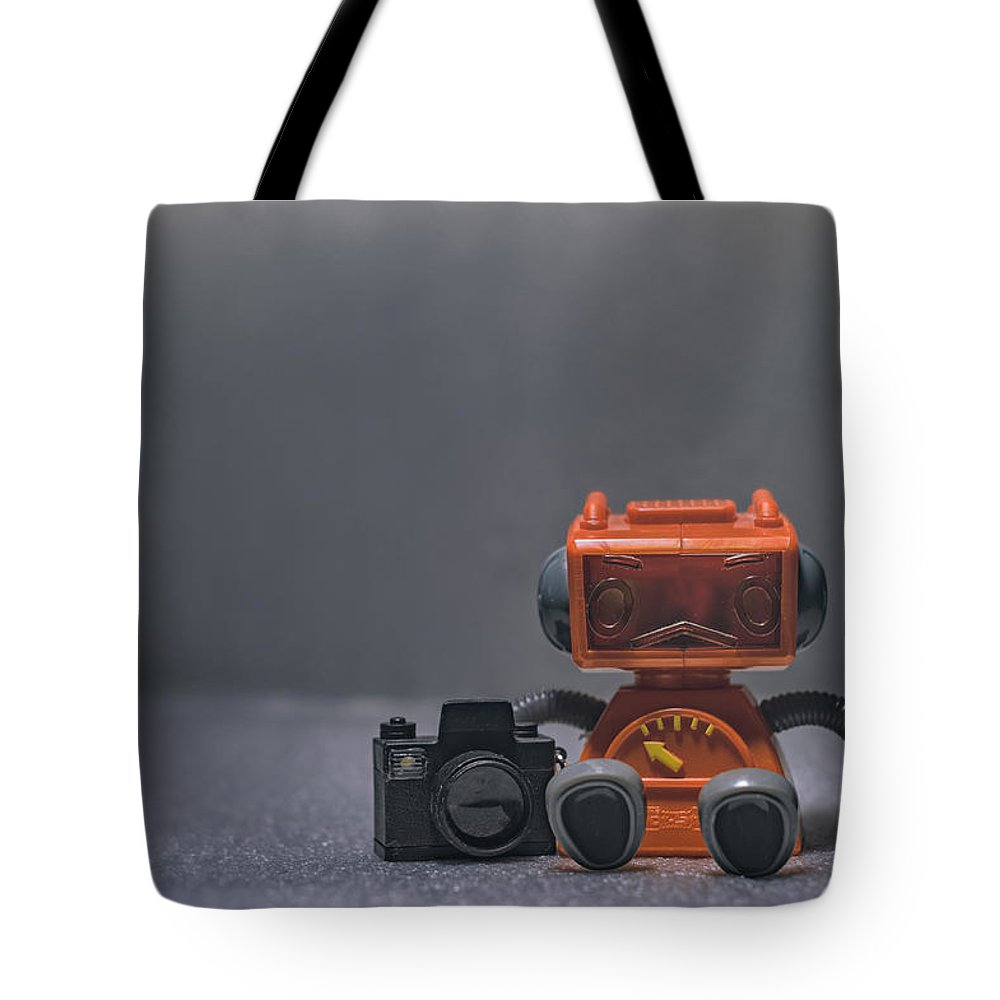 Toy Robot Tote Bag featuring the photograph The Lonely Robot Photographer by Scott Norris