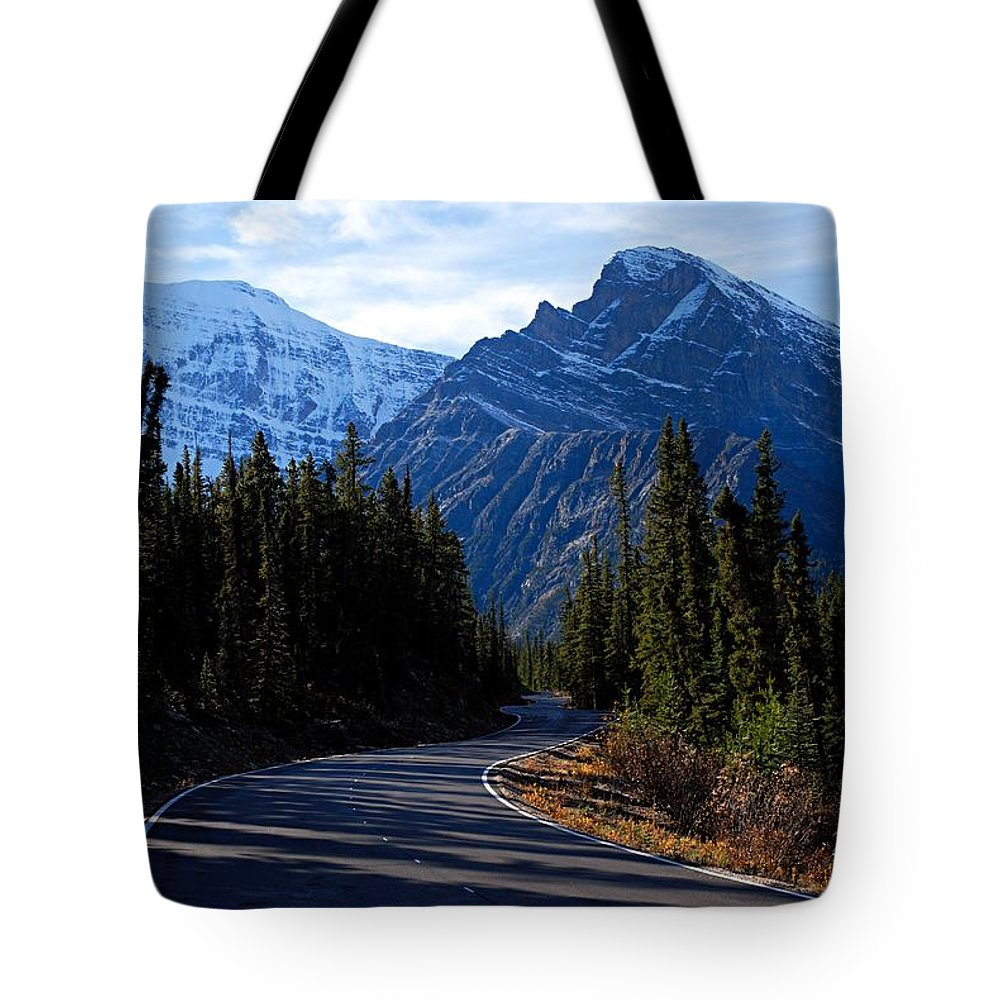 Mount Edith-cavell Tote Bag featuring the photograph The Long And Winding Road by Larry Ricker