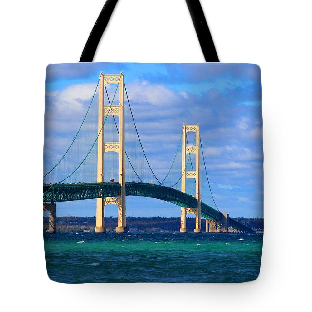 The Mackinac Bridge Tote Bag featuring the photograph The Mackinac Bridge by Michael Rucker