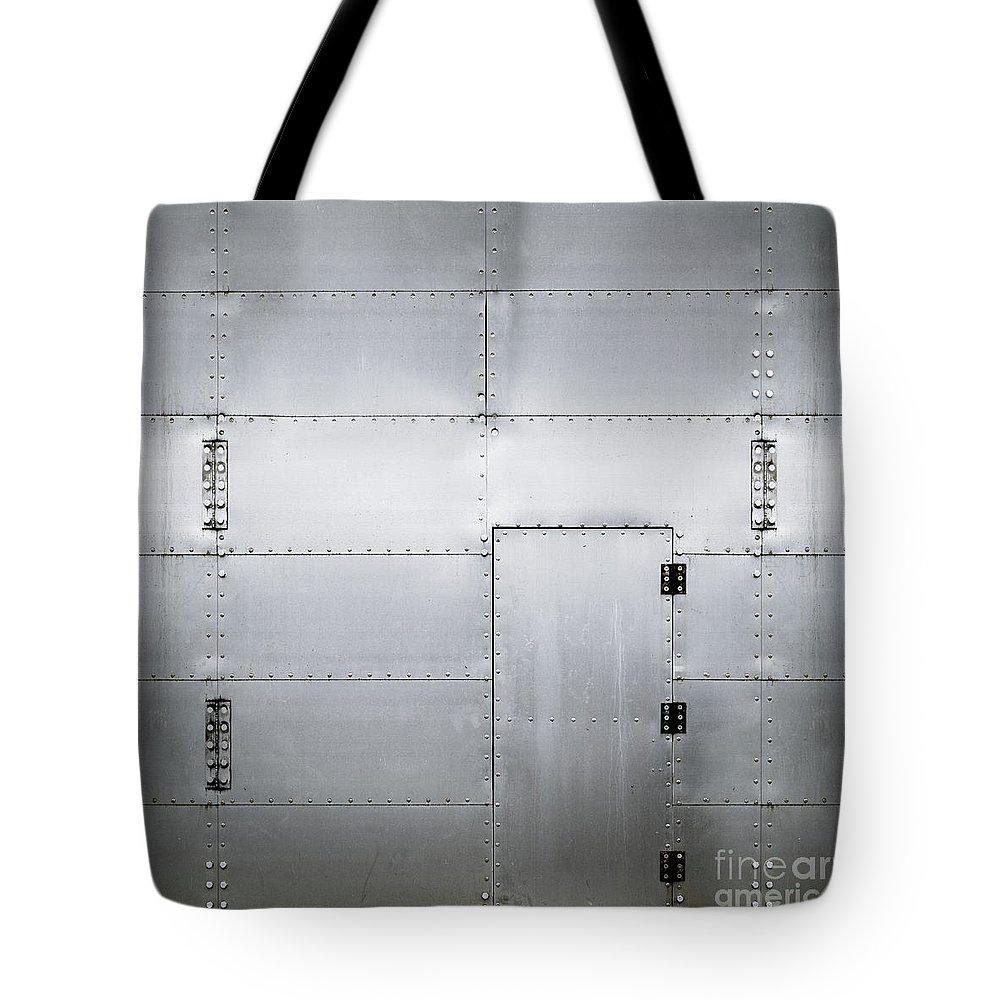 Benjamin Harte Tote Bag featuring the photograph The Metal Door by Benjamin Harte