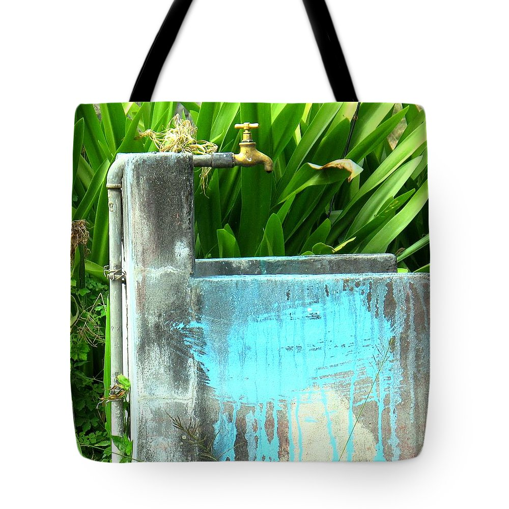 Water Tote Bag featuring the photograph The Neighborhood Water Pipe by Ian MacDonald