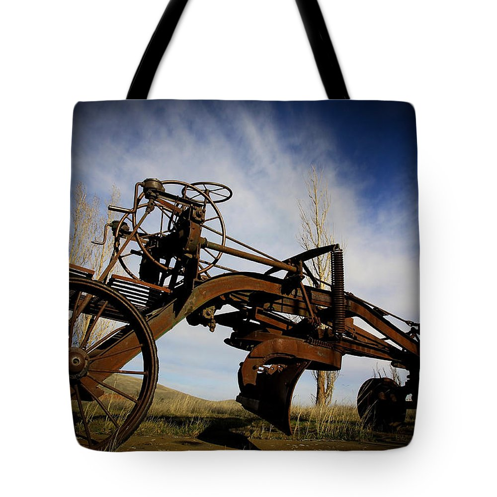 Farm Equipment Tote Bag featuring the photograph The Old Grader by Steve McKinzie