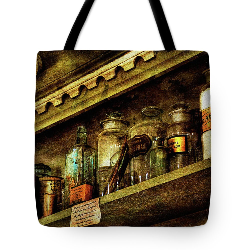 Glass Bottles Tote Bag featuring the photograph The Olde Apothecary Shop by Lois Bryan