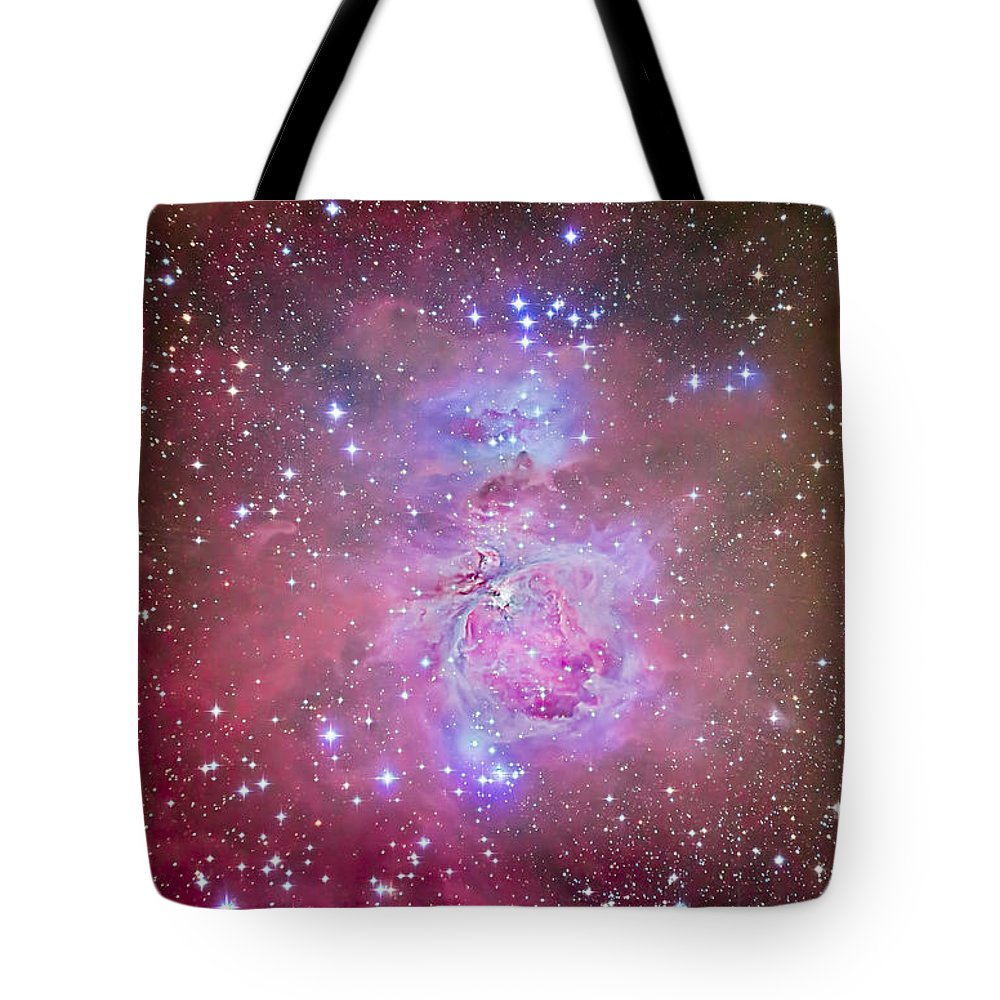Emission Nebula Tote Bag featuring the photograph The Orion Nebula Region by Alan Dyer