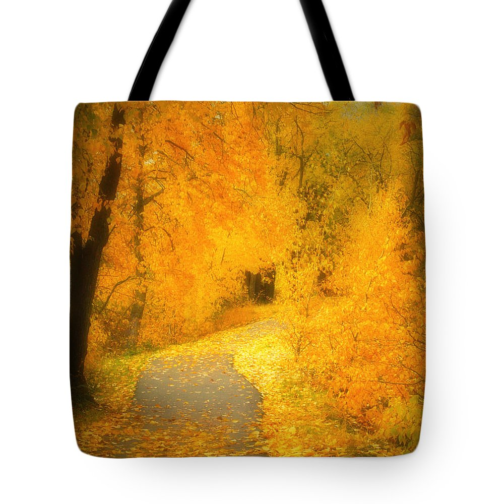 Autumn Tote Bag featuring the photograph The Pathway Of Fallen Leaves by Tara Turner